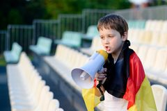 Germany fan screaming through megaphone on the stadium Royalty Free Stock Photo