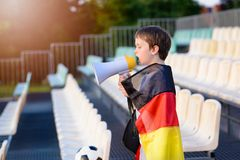 Germany fan screaming through megaphone on the stadium Royalty Free Stock Photography