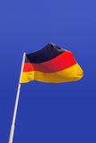 Germany flag. In a blue sky Stock Image