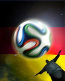 Germany Flag Brasil. Germany flag with Brazuca football and corcovado statue at Rio, Brasil 2014 Royalty Free Stock Photos