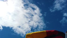 Germany flag flying in the wind on the ship. 4K video of Germany flag flying in the wind on the ship. In the background is blue sky stock footage