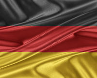 Germany flag with a glossy silk texture. Royalty Free Stock Image