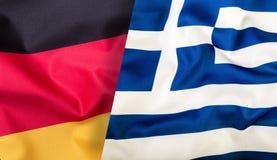 Germany Flag Greece Flag. Eu flags. Waving flag of Germany and Greece Stock Photo