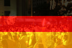 Germany flag with people praying. Royalty Free Stock Photo