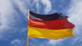 Germany flag on sky background. Old germany flag with ragged edge on sky background stock video footage
