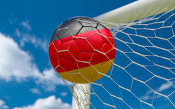 Germany flag and soccer ball in goal net Royalty Free Stock Images