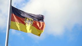 Germany flag waving on wind blowing, bright clouds float sky. Stock footage stock video