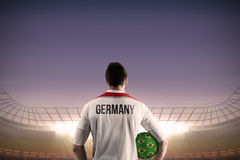 Germany football player holding ball Stock Images