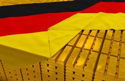 Germany gold reserve stock. (creative concept): golden bars (ingots, bullions) are covered with german flag in the storage (treasury) as symbol of national gold Royalty Free Stock Images
