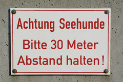 Germany, Heligoland, sign, beware of harbour seals Royalty Free Stock Images
