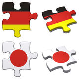 Germany & Japan puzzle. 3d rendered Germany and Japan puzzles isolated Royalty Free Stock Photography