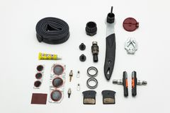 Germany, Koblenz Aprli 2018. Repairing of bicycle. Tools, parts and equipment set. Isolated on a white background. stock image