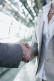 Germany, Leipzig-Halle, Airport business people shaking hands Royalty Free Stock Photos