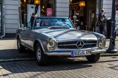 GERMANY, LIMBURG - APR 2017: silver MERCEDES-BENZ W113 230 250 280 SL CABRIO 1963 in Limburg an der Lahn, Hesse, Germany.  stock photo