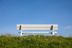 Germany, Lower Saxony, empty bench on dyke Royalty Free Stock Images