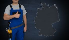 Germany map and craftsman with thumbs up.  royalty free stock images