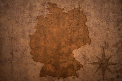 Germany map on vintage paper background. Germany map on a old vintage crack paper background royalty free stock photography