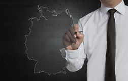Germany map is written by businessman on computer screen.  royalty free stock photo
