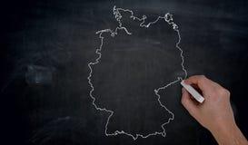 Germany map is written by hand on blackboard.  royalty free stock image