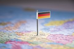 Germany marked with a flag on the map.  royalty free stock image