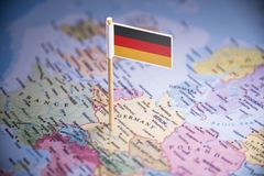 Germany marked with a flag on the map.  royalty free stock images