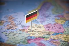 Germany marked with a flag on the map.  stock photo