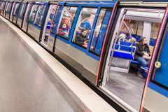 Germany, Munich, March 25, 2017, Underground railway in Munich with passengers and open doors with red light.  Stock Photos