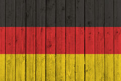 Germany national flag on old wood background Royalty Free Stock Images