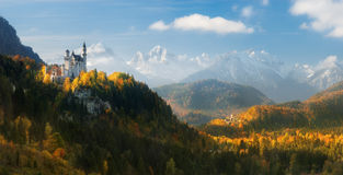 Germany. Panorama. The famous Neuschwanstein Castle and Hohenschwangau Castle on the background of snowy mountains. Neuschwanstein Castle new swan stone - the stock photo