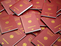 Germany passport background. Immigration or travel concept. Pile Stock Photo