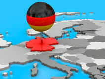 Germany pinned to map of Europe. Red Germany pinned to the map of Europe with a big push pin coloured as the German flag Stock Photography