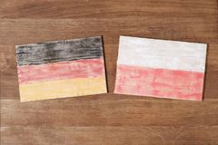 Germany and Poland flag, concept cooperation friendship on wood background. Germany and Poland flag, concept cooperation competition friendship on wood Stock Images