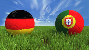 Germany-Portugal. 3D soccer balls with germany and portugal flag, world football cup 2014. Palaced on 3d grass. Background isolated with clipping path Stock Images