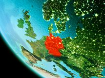 Germany in red in the evening. Country of Germany in red on planet Earth in the evening. 3D illustration. Elements of this image furnished by NASA Stock Photography