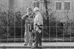 Germany, Regensburg, March 17, 2017, Construction worker at the Watergate in Regensburg during cleaning procedure Royalty Free Stock Image