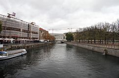 Germany River in Berlin.2018. River in Berlin.Above are clouds.The left side is the building and the ship.On the right side there is a small park and trees stock image