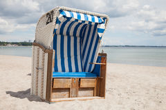 Germany, Schleswig-Holstein, Baltic Sea, beach chair at beach. Germany, Schleswig-Holstein, Baltic Sea with beach chair at beach Stock Photos
