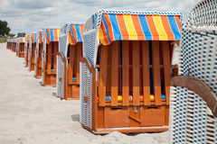 Germany, Schleswig-Holstein, Baltic Sea, closed beach chairs at. Germany, Schleswig-Holstein, Baltic Sea row of closed beach chairs at beach stock image