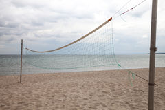 Germany, Schleswig-Holstein, Baltic Sea, volleyball net on beach Stock Image