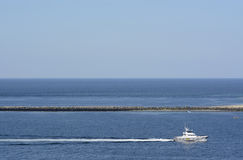 Germany, Schleswig-Holstein, Heligoland, harbour and motorboat Royalty Free Stock Photos