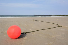 Germany, Schleswig-Holstein, Heligoland, North Sea, beach, buoy at low tide Royalty Free Stock Photography