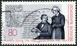 GERMANY - 1985: shows portrait brothers Wilhelm (1786-1859) and Jacob (1785-1863) Grimm, Deutches Worterbuch Royalty Free Stock Photography