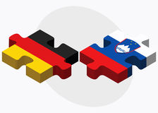 Germany and Slovenia Flags in puzzle isolated on white background Royalty Free Stock Photography