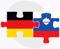 Germany and Slovenia Flags in puzzle isolated on white background Royalty Free Stock Image