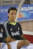 Germany soccer player  Mesut Ozil during a gameplay in Mallorca. Germany soccer player Mesut Özil gestures from Real Madrid bench during his league match in Royalty Free Stock Image