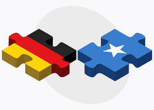 Germany and Somalia Flags in puzzle isolated on white background Royalty Free Stock Photos