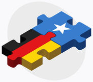 Germany and Somalia Flags in puzzle isolated on white background Royalty Free Stock Image