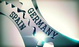 Germany Spain - Inscription on Mechanism of Metal Cogwheels. 3D. Royalty Free Stock Photo