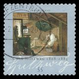 The poor Poet by Carl Spitzweg. Germany - stamp 2008: Color edition on Art, shows Painting The poor Poet by Carl Spitzweg royalty free illustration