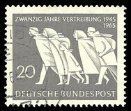 East German Refugees. Germany - stamp 1965: Color edition on Second World War, shows 20th Anniversary of Influx of East German Refugees stock images